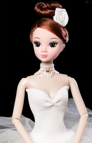 Front of Ballerina Doll wearing white tutu
