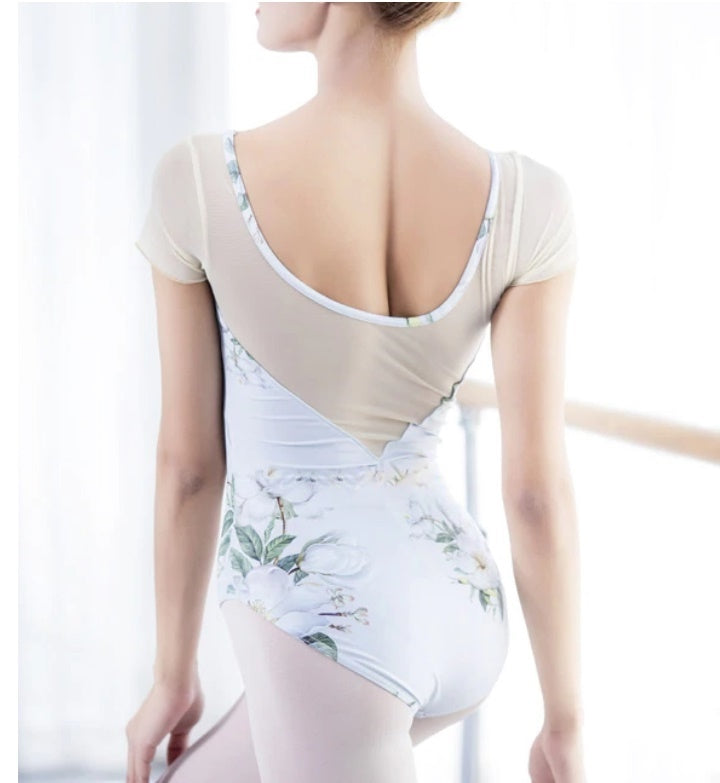 back of woman wearing white floral leotard ballet and dance