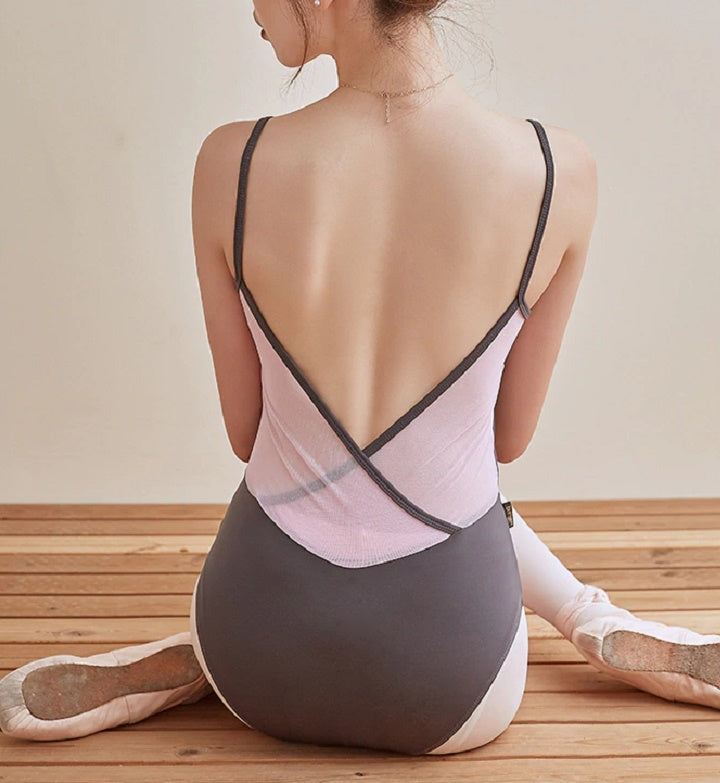 Back of pinched front camisole leotard with mesh back in pink and gray.