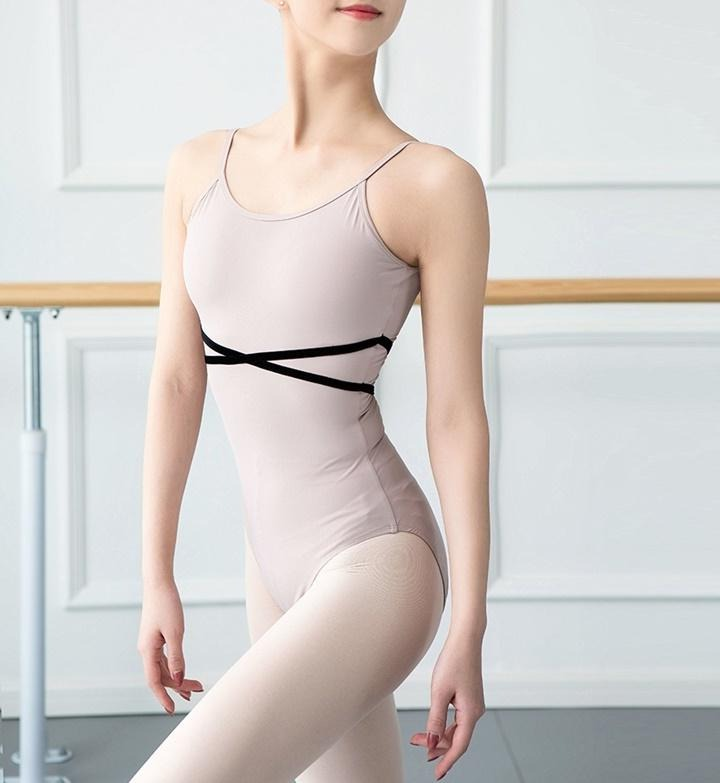 pale pink camisole leotard with black cross belt