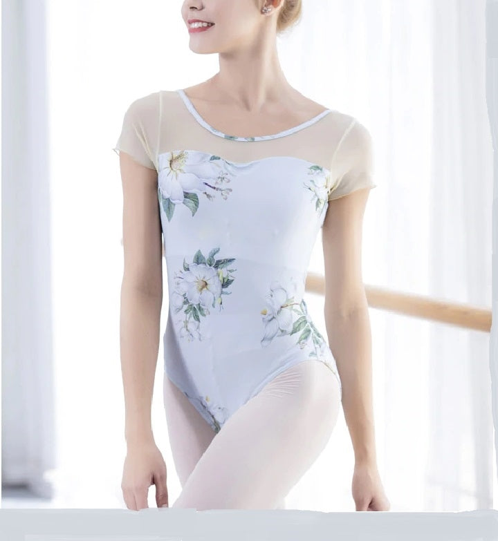 front of woman wearing white floral leotard ballet and dance