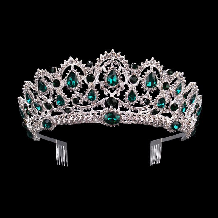 Front of silver tone ballet weddingcrown/tiara with emerald jewels.