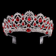Front of silber tone wedding ballet crown/tiara with ruby colored jewels.