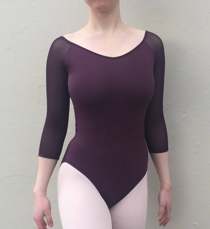 Front of woman wearing plum mesh 3/4sleeve ballet leotard