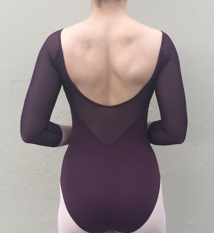 Back of woman wearing plum mesh 3/4 sleeve ballet leotard