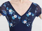 front of floral and blue short sleeved women's leotard