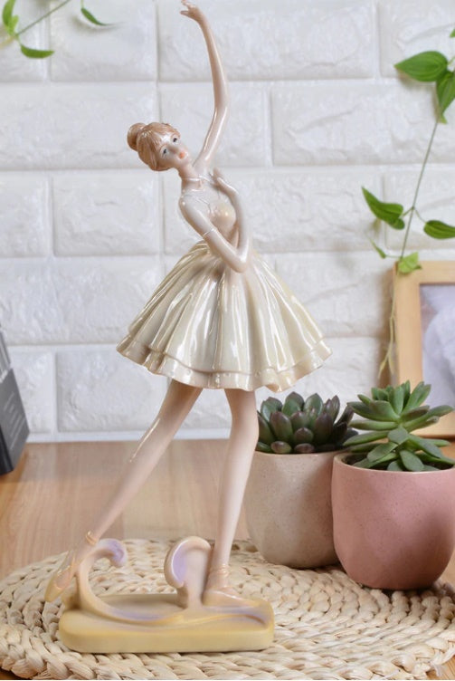 front of ballet dancer figurine wearing white skirt