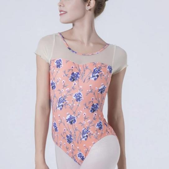 front of woman wearing pink floral leotard ballet and dance