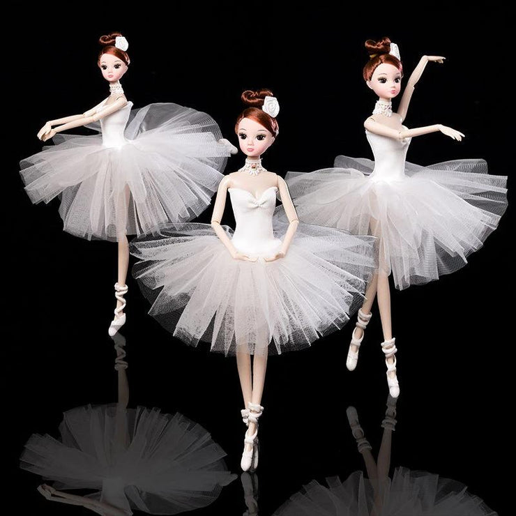Front of three Ballerina Dolls wearing white tutu