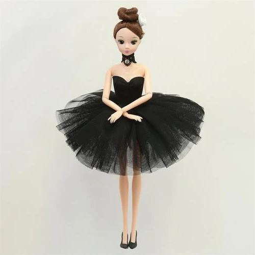 Front of Ballerina Doll wearing black tutu