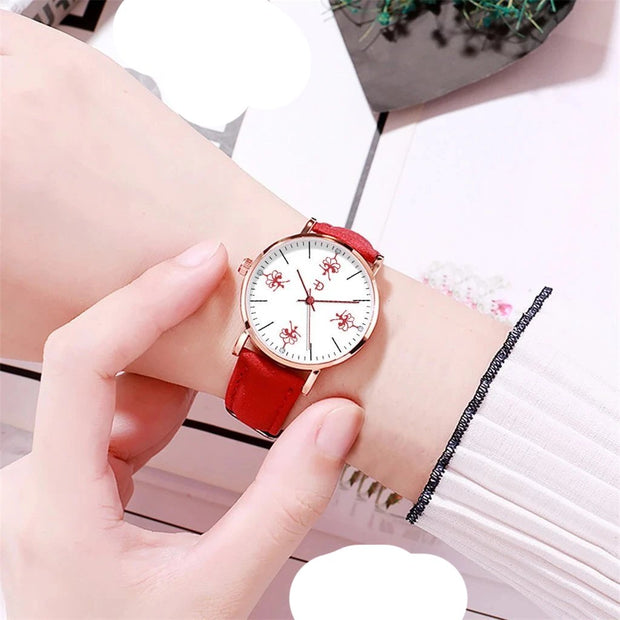 Woman wearing dancer ballerina watch with red band