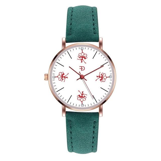 Front of dancer ballerina watch with green band