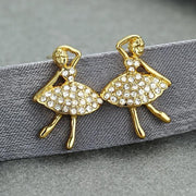 Pair of gold toned ballerina earrings with crystal