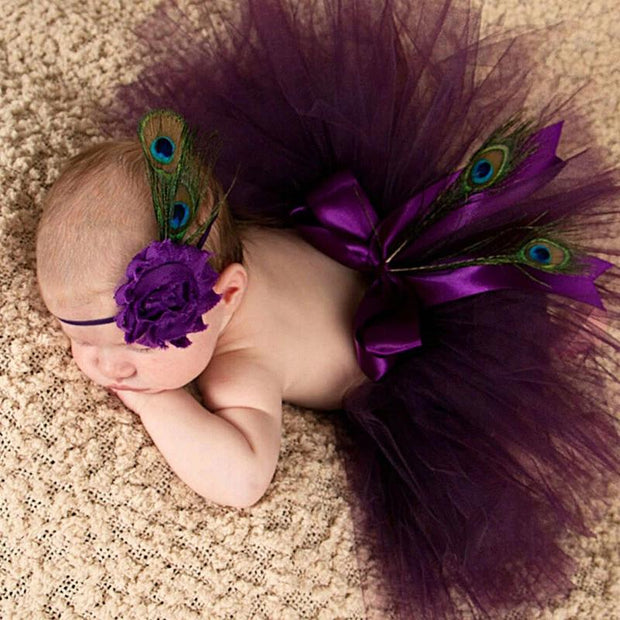 newborn plum colored ballerina tutu with peacock feathers and headband
