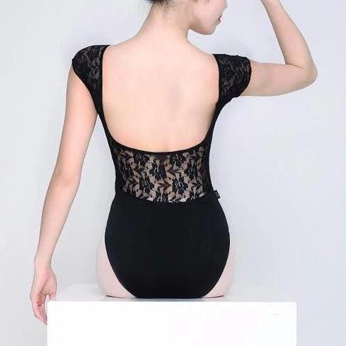 woman wearing black leotard with lace back