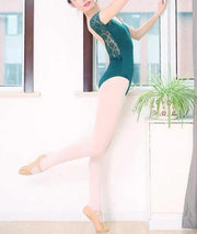 woman wearing green leotard with lace sleeves and back
