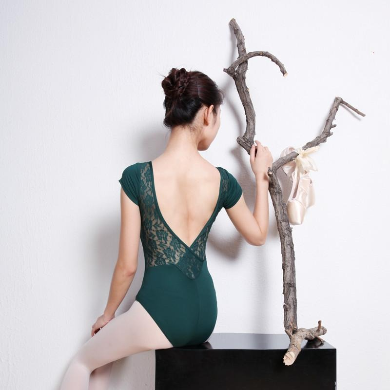 woman wearing green lace back leotard
