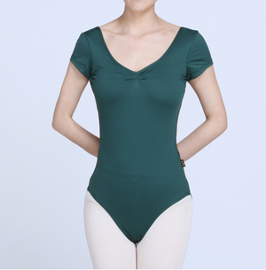 woman wearing green colored lace back leotard