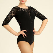 woman wearing black dance bodysuit with lace