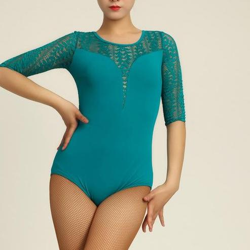 woman wearing turquoise bodysuit with lace