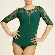 woman wearing green dance bodysuit with lace