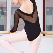 back of woman wearing long sleeve black leotard