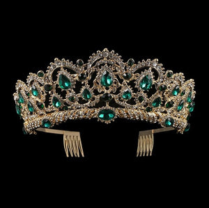 Front of gold tone ballet wedding crown/tiara with emerald jewels.