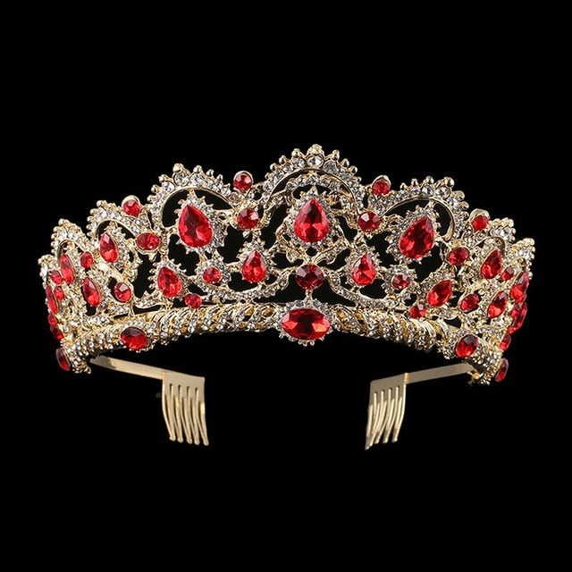 Front of gold tone ballet and wedding crown/tiara with ruby colored jewels.