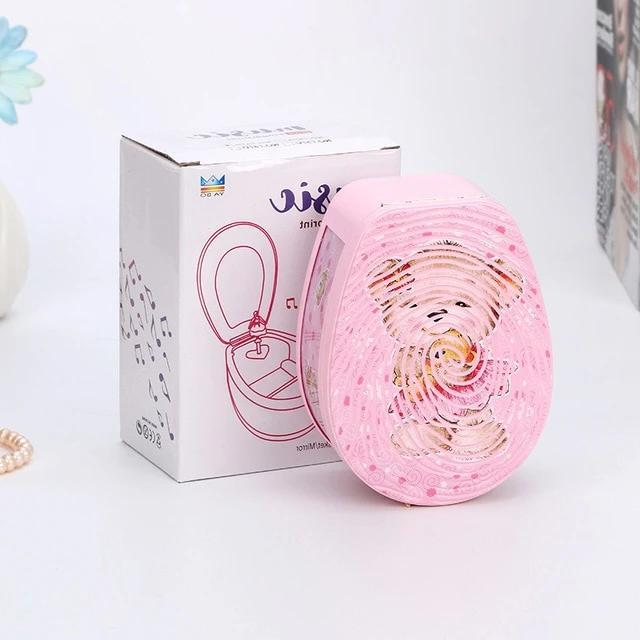 Top of pink ballerina music box with cartoon bear