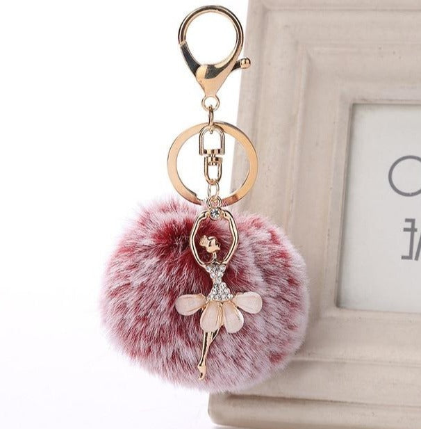 red and white frosted ballerina keychain
