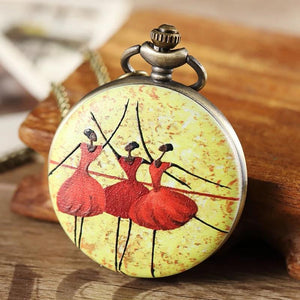 Front of ballerina pocket watch with three black ballerinas wearing red tutus