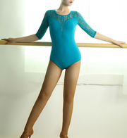 Woman wearing turquoise dance body suit with lace