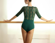 back of woman wearing green dance bodysuit with lace