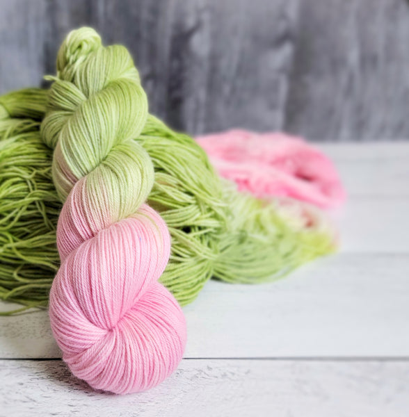 Petal-  Hand dyed yarn - SW Merino Fingering knitting crocheting weaving- pink green palindrome