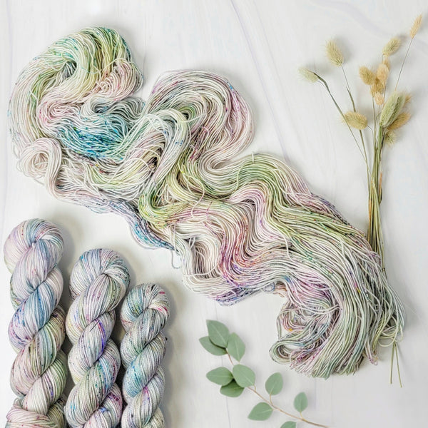 Pieces of April - Hand dyed sock yarn - pastel sage grey with speckles of pink blue green toffee