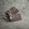 Set of His and Hers Stamped Leather Luggage Tags