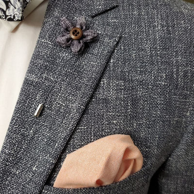 grey lapel pin