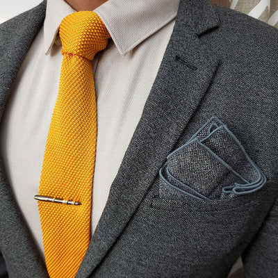 Knitted Dijon Tie Set with a charcoal suit
