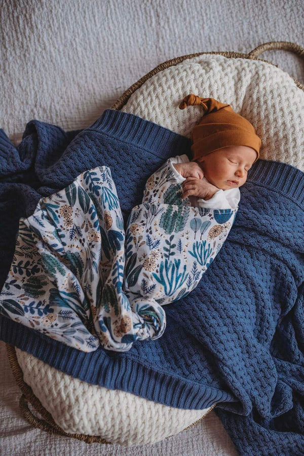 baby wrapped in arizona swaddle