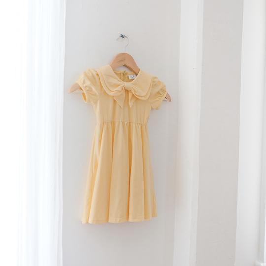 Dafodil Bow Dress hanging