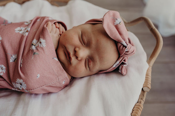 Close-up of daisy swaddle and topknot set