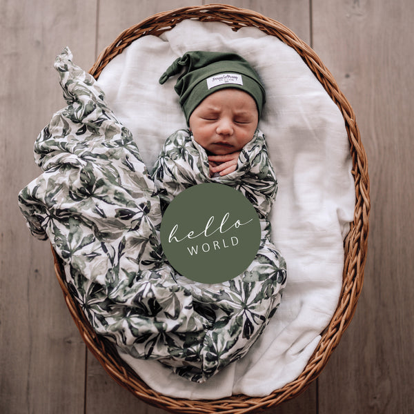 Evergreen swaddle with matching milestone card