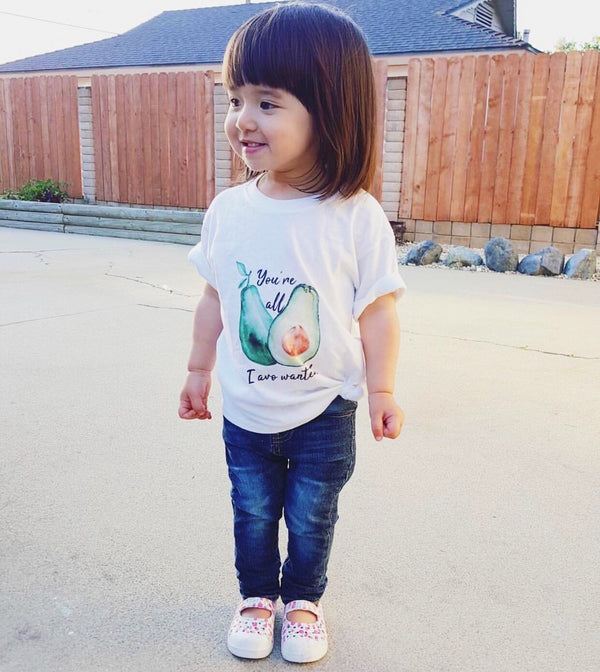 Child wearing all I avo wanted tee
