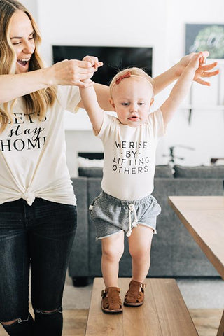 We Rise By Lifting Others - Onesie - Little Cherished Co.
