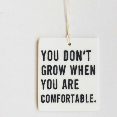YOU DON'T GROW WHEN YOU ARE COMFORTABLE PORCELAIN WALL TAG