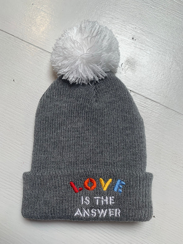 LOVE IS THE ANSWER POM POM BEANIE