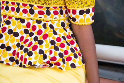 Colorful African print blouse and yellow skirt