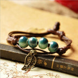 Nice green beads bell pendant black leather chain bracelet