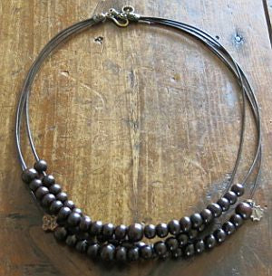 Sandalwood Rosary Necklace, 3 strand on leather