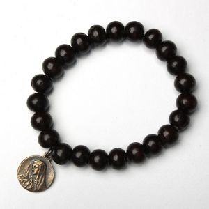 Our Lady of Sorrows Medal on a sandalwood bracelet
